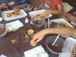 girls making chocolate lollipops